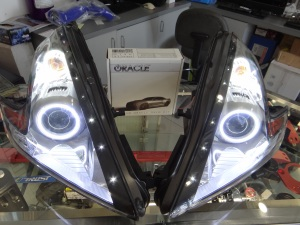 A set of illuminated 370Z Oracle Halo headlamps before installation.